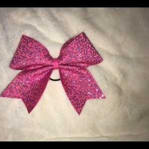 Pink sequence cheer bow